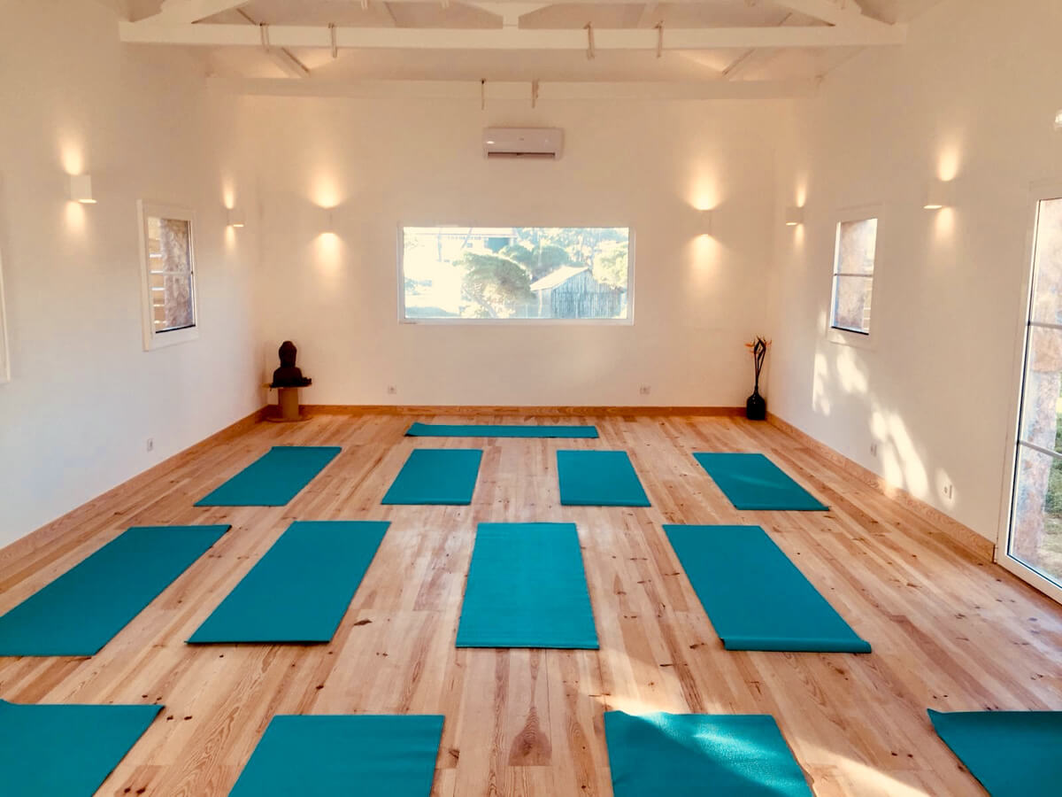 One of our rooms with yoga mats spaced out on the floor.