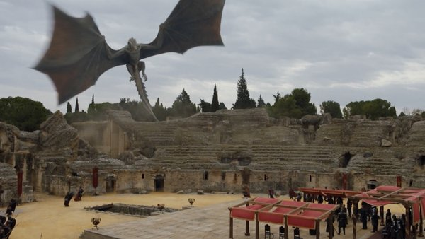 A view of Daenerys' dragon preparing to land in the dragon pit (The Amphitheatre)