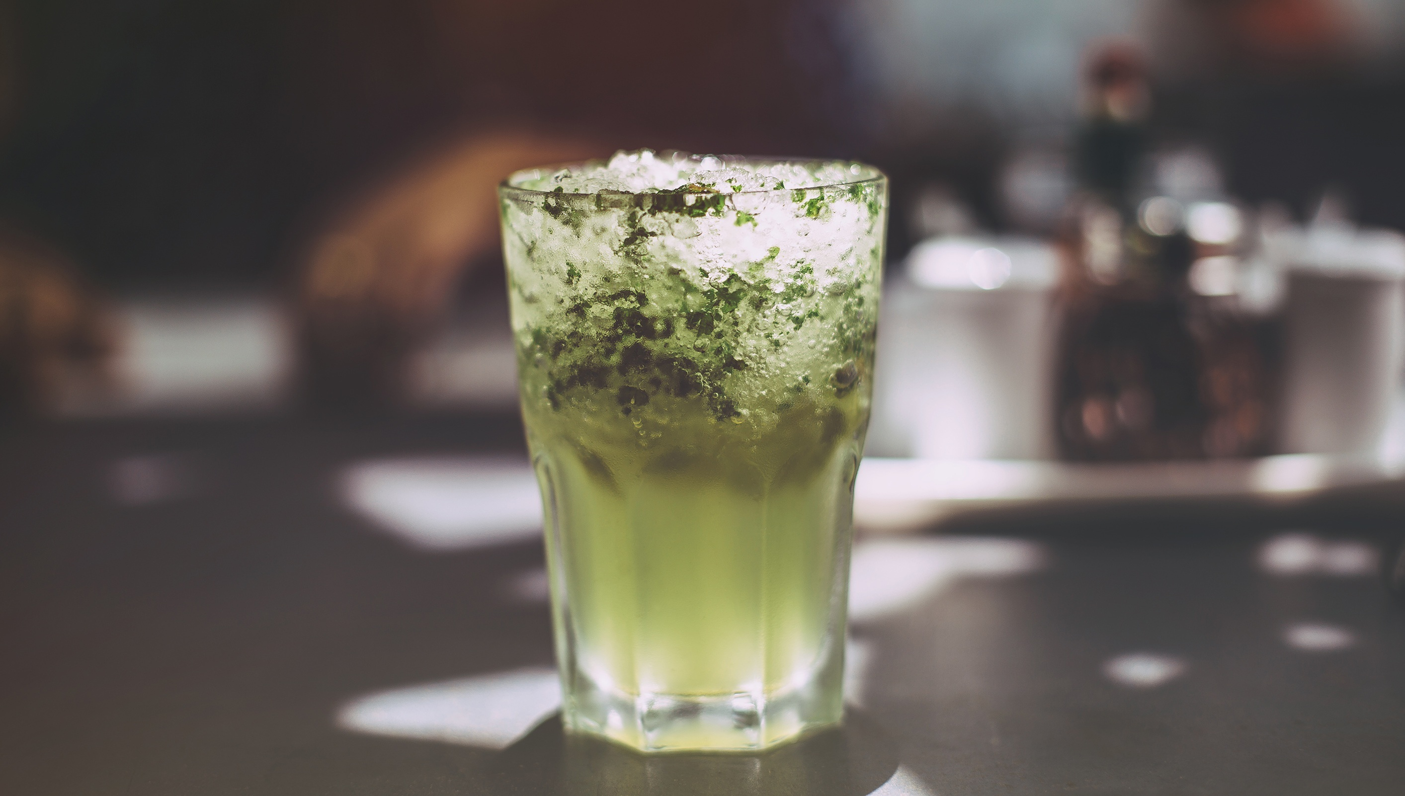 A close up image of a classic Mojito cocktail