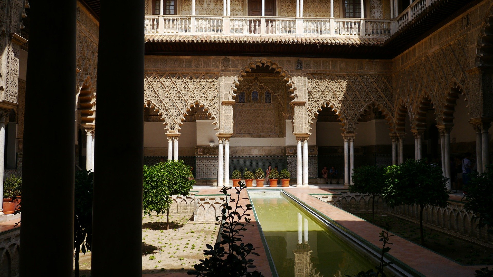 A landscape photo taken from with the Alcazar Palace looking onto the patio