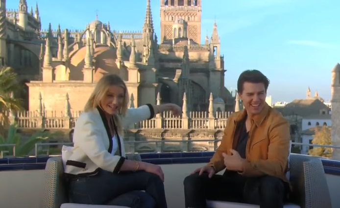 Tom Cruise & Cameron Diaz sitting down on a rooftop terrace with the Cathedral proudly showing in the background