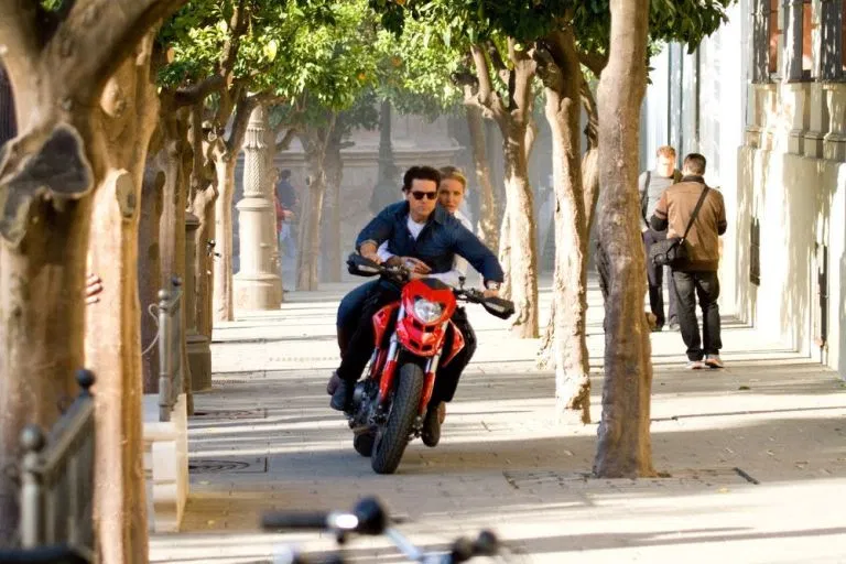 A scene of Tom Cruise speeding through the streets of seville on his motorbike with Cameron Diaz gripped to his back