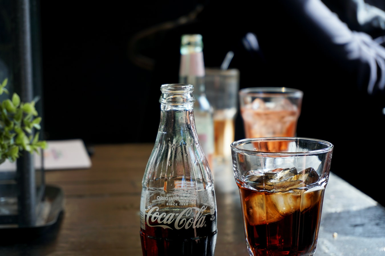 A glass bottle of Coca-Cola and a Calimocho Drink