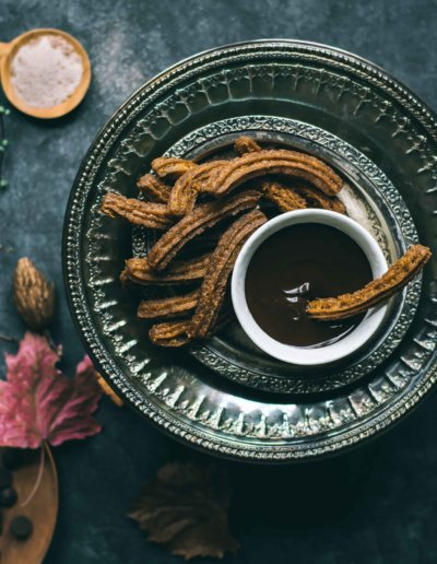 Churros con Chocolate served on a table