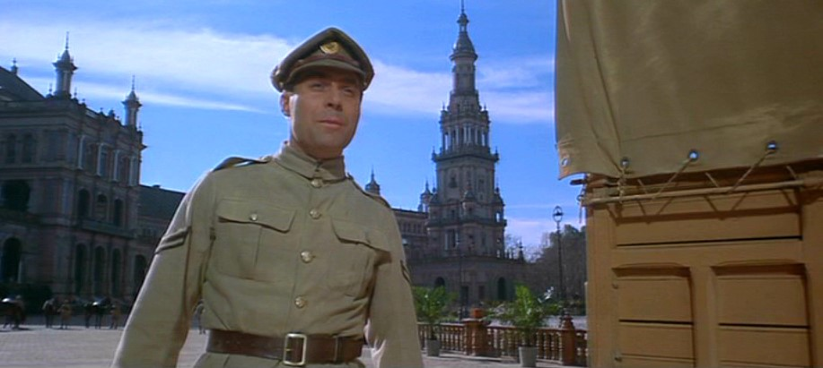 A shot taken of an actor playing a soldier, stood outside La Palace de España.